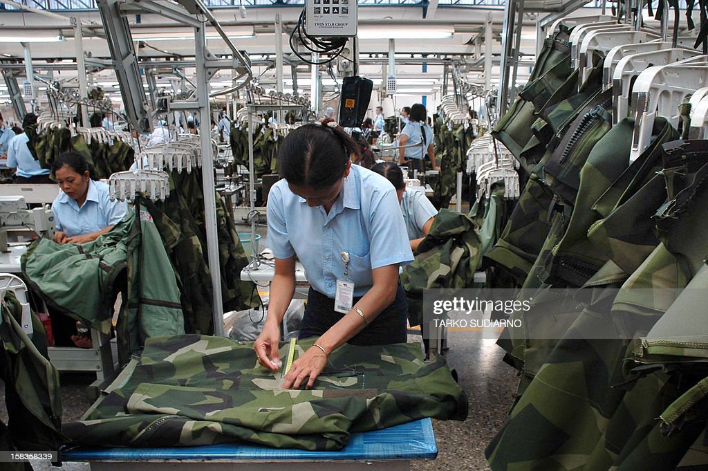 In this photograph taken on December 13, 2012, an employee of the Sritex textile and garment company sews military uniforms at the factory in Solo in Central Java province. Sritex, an Indonesian company and one of the largest textile makers in Southeast Asia, employs more than 15,000 people to manufacture military uniforms for some 27 countries, including Oman, Qatar, Kuwait, Lebanon, Australia, Singapore, Brunei and NATO countries.