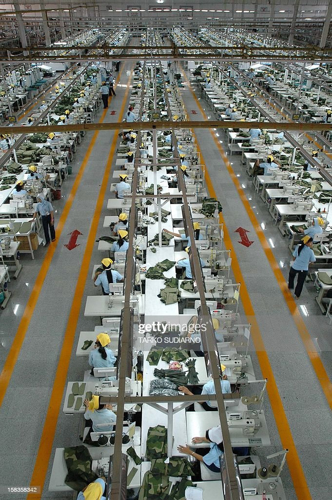 In this photograph taken on December 13, 2012, hundreds of employees of the Sritex textile and garment company sew military uniforms at the factory in Solo in Central Java province. Sritex, an Indonesian company and one of the largest textile makers in Southeast Asia, employs more than 15,000 people to manufacture military uniforms for some 27 countries, including Oman, Qatar, Kuwait, Lebanon, Australia, Singapore, Brunei and NATO countries. AFP PHOTO / TARKO SUDIARNO