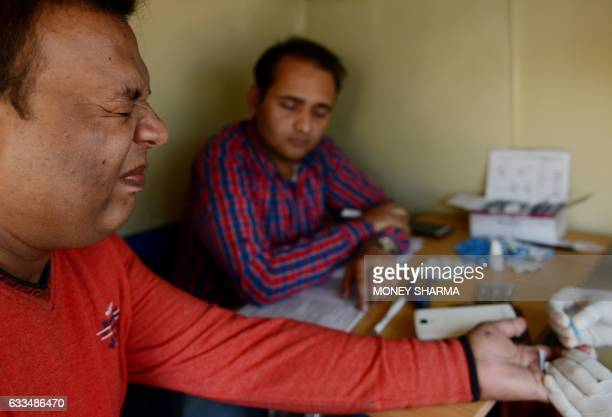 In this photograph taken on December 19 transgender Indian resident Neetu Rao has a blood test in New Delhi From setting up his own charity to...