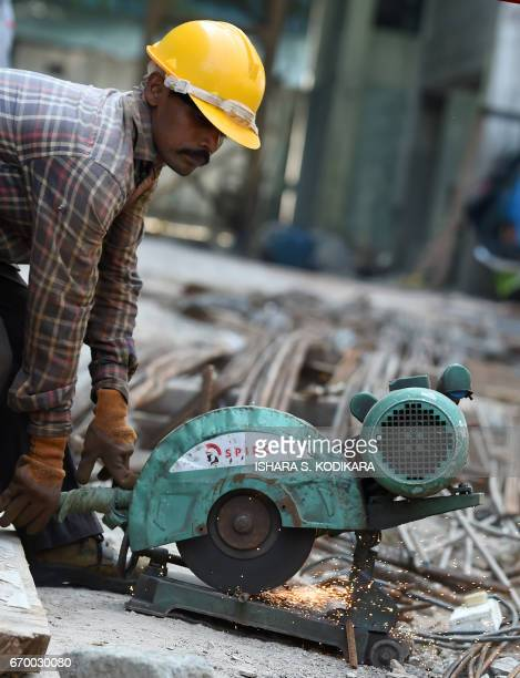 In this photograph taken on December 7 a Sri Lankan construction labourer works on a new apartment building at a complex in Colombo Cheap Sri Lankan...