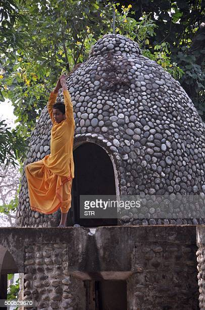 In this photograph taken on December 8 an Indian devotee practices yoga at the Beatles ashram as the former ashram of the selfstyled guru Maharishi...