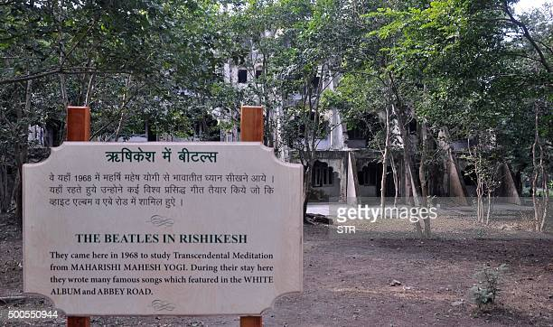 In this photograph taken on December 8 an information sign about the Beatles is seen in front of dwellings at the Beatles ashram as the former ashram...