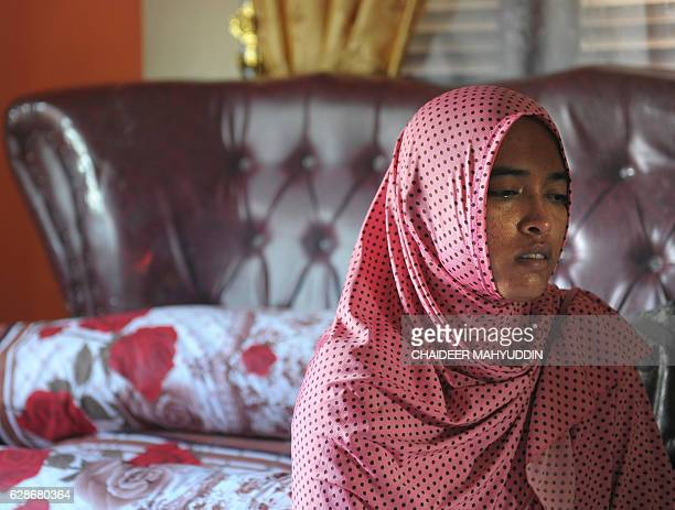 In this photograph taken on December 8 Yusra Fitriani mourns in a room which was supposed to be her bridal bedroom in Pidie Jaya Aceh province On her...