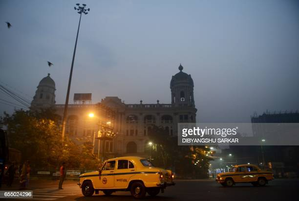 In this photograph taken on February 14 Hindustan Motors Ambassador taxis drive on a street in Kolkata India's Hindustan Motors has sold its...