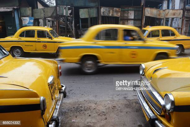 In this photograph taken on February 14 Indian Hindustan Motors Ambassador taxis stand parked on a street in Kolkata India's Hindustan Motors has...