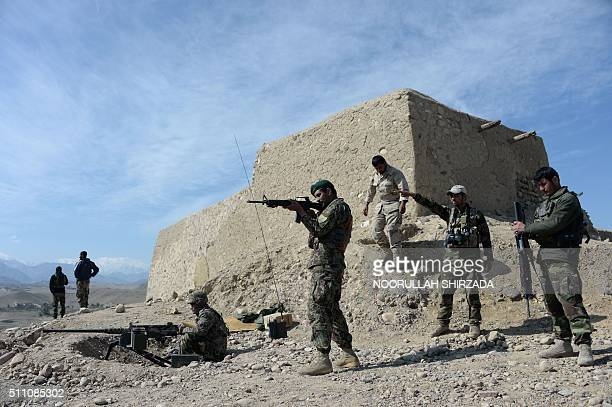 In this photograph taken on February 17 Afghan security forces patrol following an operation against Islamic State militants in Achin district in...