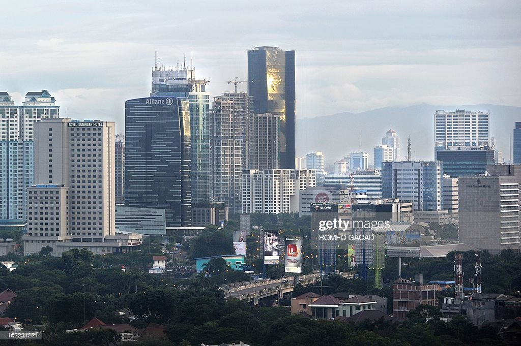 In this photograph taken on February 18 the black glass building of Bakrie Tower that houses the head office of Bumi Resources is seen in the center...