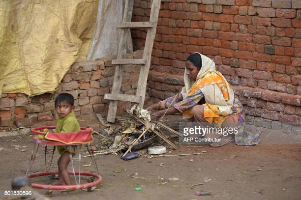 In this photograph taken on February 2 thirtyyearold Bushra Bibi who sold one of her kidneys cleans a courtyard at her home in Bhalwal in Sargodha...