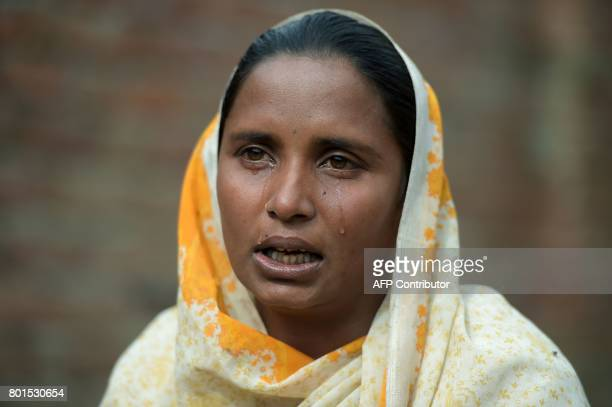 In this photograph taken on February 2 thirtyyearold Bushra Bibi who sold one of her kidneys cries as she speaks during an interview with AFP at her...