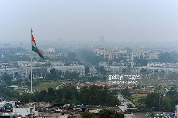 In this photograph taken on February 24 shows the Indian tricolour as it flies over Connaught Place in New Delhi ahead of World Environment Day which...