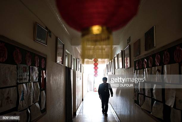 In this photograph taken on February 7 a child walks down a hallway in an orphanage on the outskirts of Beijing the eve of the Lunar New Year While...