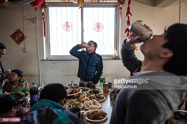 In this photograph taken on February 7 children drink during lunch in an orphanage on the outskirts of Beijing the eve of the Lunar New Year While...