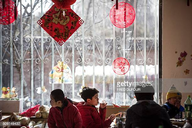 In this photograph taken on February 7 children eat their lunch in an orphanage on the outskirts of Beijing the eve of the Lunar New Year While...