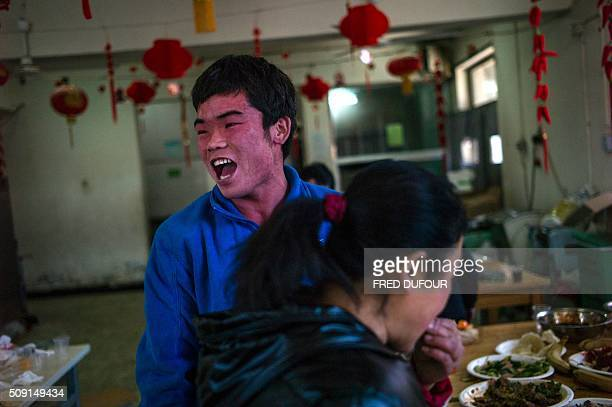 In this photograph taken on February 7 children play after eating their lunch in an orphanage on the outskirts of Beijing the eve of the Lunar New...