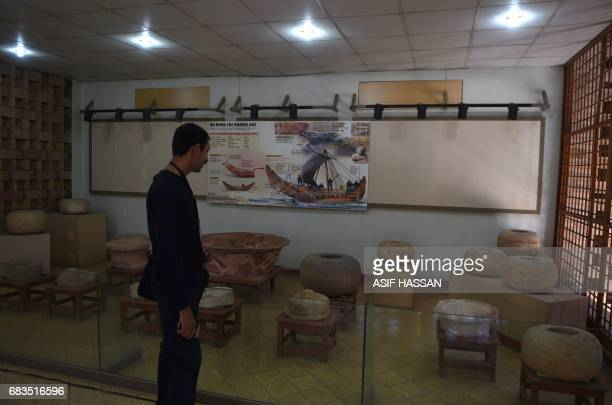 In this photograph taken on February 9 a Pakistani visitor walks through the museum at the UNESCO World Heritage archeological site of Mohenjo Daro...