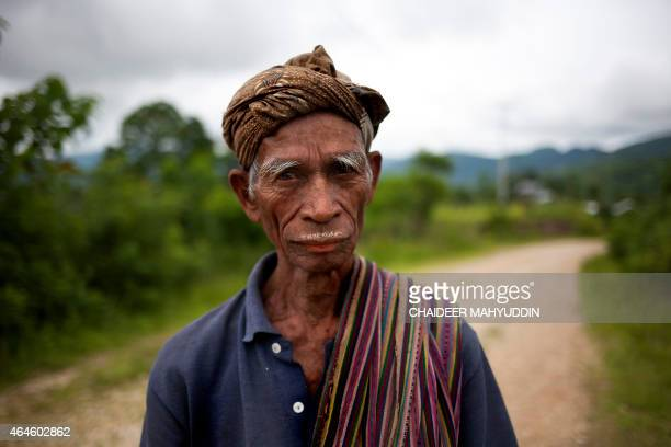 In this photograph taken on February 9 an Indonesian farmer walks to a farm in Atambua town West Timor The town located near the border to...