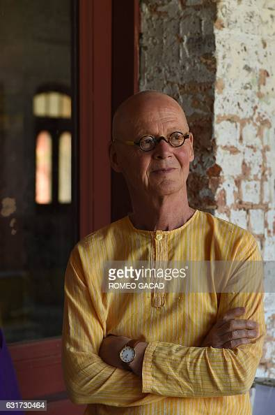 In this photograph taken on January 14 multiawarded German conceptual artist Wolfgang Laib is seen at the hallway of the historic Secretariat...