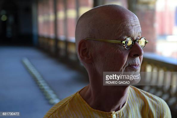In this photograph taken on January 14 multiawarded German conceptual artist Wolfgang Laib is seen in front of his row of brass plates with rice...