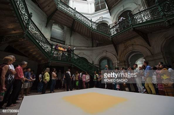 In this photograph taken on January 14 multiawarded German conceptual artist Wolfgang Laib addresses the audience above his white and yellow pollen...