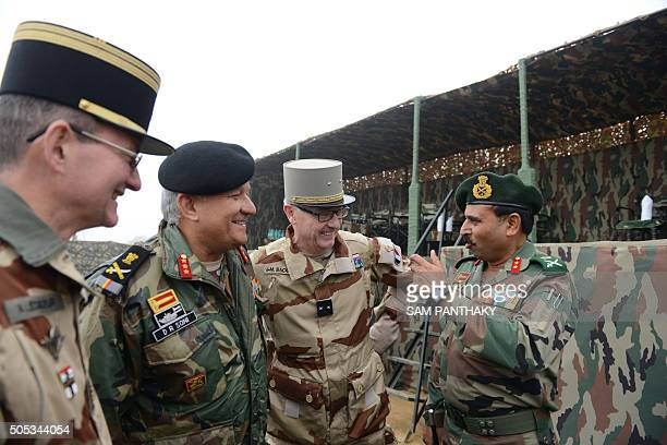 In this photograph taken on January 16 Indian Lieutenant General D R Soni GOC Chetak Corps French Brigadier General JeanMarc Bacqet and officers...