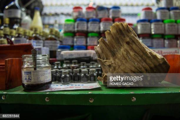In this photograph taken on January 19 a chunk of elephant teeth seen at right is displayed at the traditional medicine shop at the sprawling grounds...
