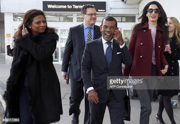 In this photograph taken on January 21 former Maldives president Mohamed Nasheed his wife Laila Ali and British lawyer Amal Clooney look on after...