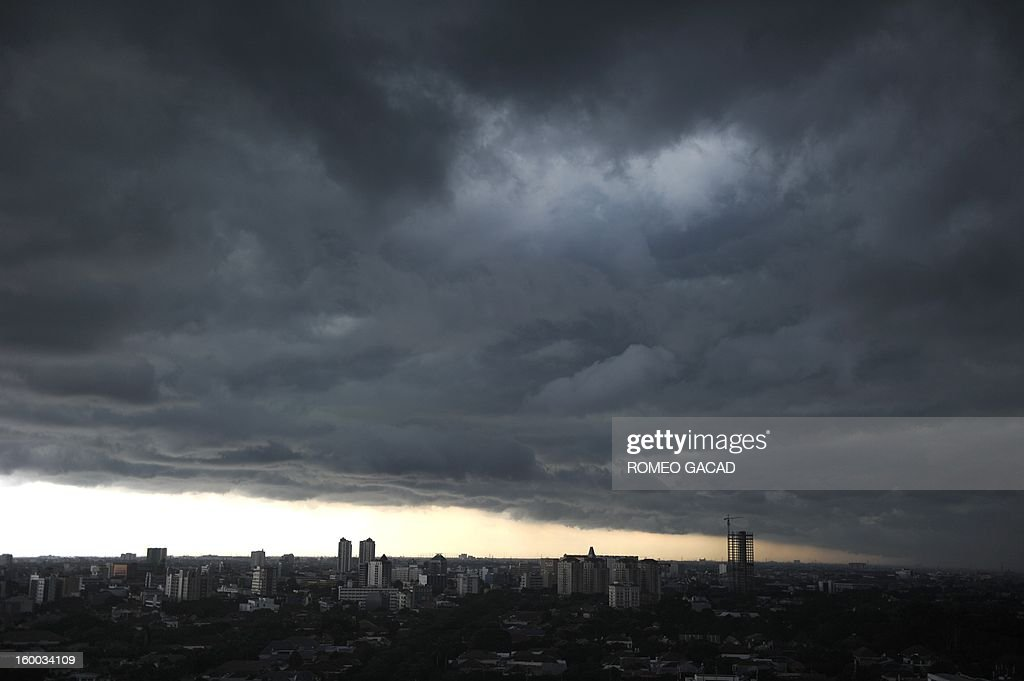 In this photograph taken on January 23, 2013, heavy rain clouds hang over the Indonesian capital city of Jakarta on January 23, 2013 while parts of the city remains submerged from flood waters for a week. Indonesian authorities will use generators and cloud-seeding measures to defuse and push away rain-laden clouds to avoid more flooding that has paralysed Jakarta, an official said on January 25.
