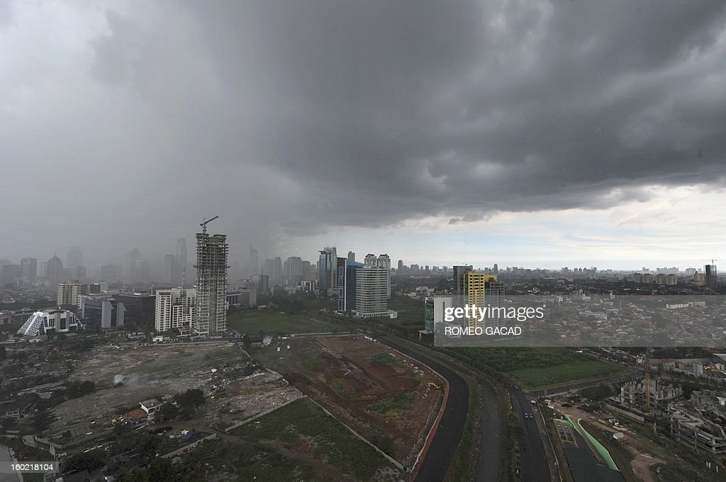 In this photograph taken on January 27, 2013 heavy rain clouds dump rain over some areas of Jakarta. Indonesian authorities used generators and cloud-seeding measures on January 26 in the hope of defusing and pushing away rain-laden clouds to avoid more flooding that has paralysed Jakarta. The weather agency has forecast heavy rain for January 28, raising concerns that Jakarta -- which combined with its satellite cities is home to 20 million people -- may get submerged again. AFP PHOTO / ROMEO GACAD