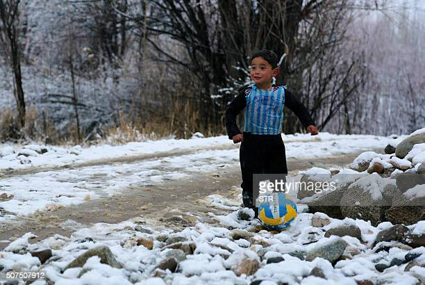 In this photograph taken on January 29 Afghan boy and Lionel Messi fan Murtaza Ahmadi wears a plastic bag jersey as he plays football in Jaghori...
