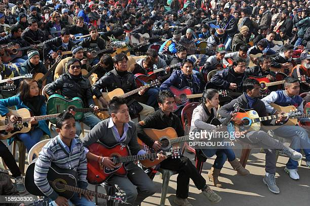 In this photograph taken on January 3 musicians play John Lennon's 'Imagine' in a memorial tribute to the 23year old Indian gang rape victim during a...