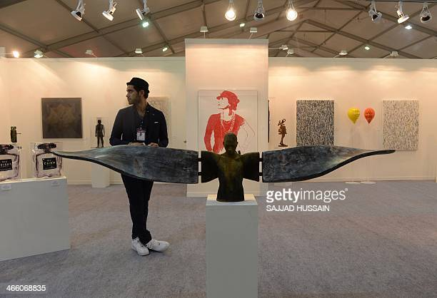 In this photograph taken on January 30 an Indian exhibitor stands at his stall during the India Art Fair in New Delhi The India Art fair has been...