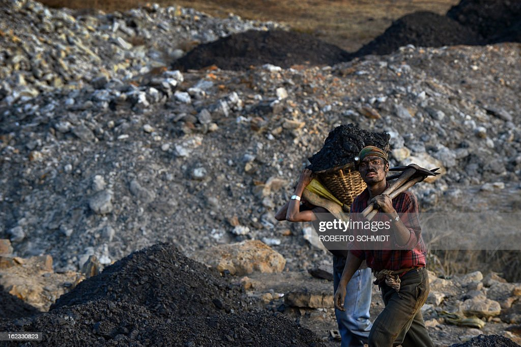 In this photograph taken on January 31, 2013, miners exit the shaft of a coal mine near Mulang village in the Indian northeastern state of Meghalaya. Thousands of private mines employ slim men and boys that will fit in thin holes branching out from deep shafts dug out from the ground in the East Jaintia Hills in Northeastern Indian state of Meghalaya. This state is the only state in India where coal mining is done privately by mine owners, who use cheap labour to supply the demand for this energy resource. Accidents and quiet burials are commonplace, with years of uncontrolled drilling making the rat-hole mines unstable and liable to collapse at any moment. After decades of unregulated mining, the state is due to enforce its first-ever mining policy later this year. AFP PHOTO/ Roberto Schmidt
