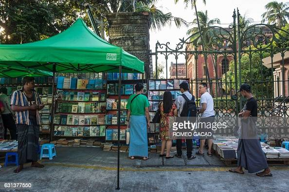In this photograph taken on January 7 vendors and customers look at books displayed outside the historic Secretariat Building as the sidewalk is...