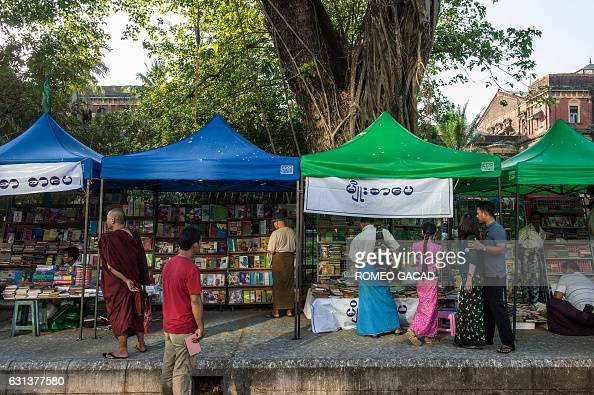 In this photograph taken on January 7 vendors and customers look at book displays outside the historic Secretariat Building as the sidewalk is...