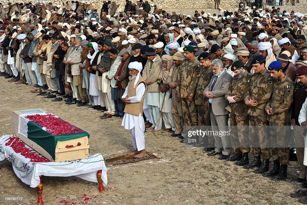 In this photograph taken on January 8, 2013 Pakistani army officials and relatives offer funeral prayers at the coffin of soldier Mohammad Aslam, who was killed in a border post attack in the Haji Pir sector in Pakistan-administered Kashmir, during his funeral in Khairpur village Chakwal district. Pakistani and Indian troops exchanged fire on January 6 along their hotly disputed border in divided Kashmir, with each side accusing the other of starting the clash. Pakistan on January 9 denied an Indian claim that its troops killed two Indian soldiers in a cross-border attack on January 8 that has raised tensions in South Asia, a military official said.