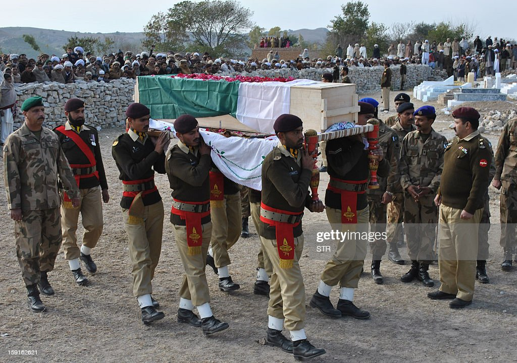 In this photograph taken on January 8, 2013 Pakistani army personnel carry the coffin of soldier Mohammad Aslam, who was killed in a border post attack in the Haji Pir sector in Pakistan-administered Kashmir by Indian army, during his funeral in Khairpur village Chakwal district. Pakistani and Indian troops exchanged fire on January 6 along their hotly disputed border in divided Kashmir, with each side accusing the other of starting the clash. Pakistan on January 9 denied an Indian claim that its troops killed two Indian soldiers in a cross-border attack on January 8 that has raised tensions in South Asia, a military official said.