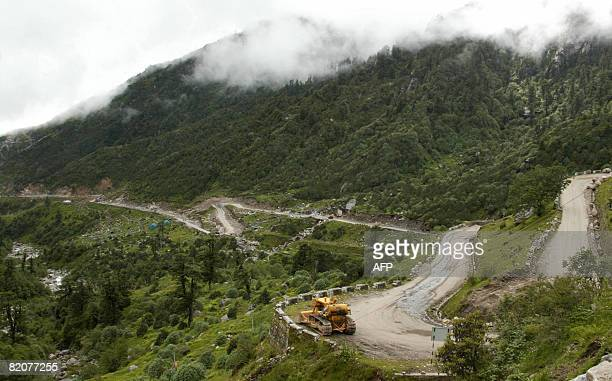 GUPTA 'INDIACHINADIPLOMACYTRADE' In this photograph taken on July 10 2008 a bulldozer makes its way along the Nathu La Pass close to the ancient...