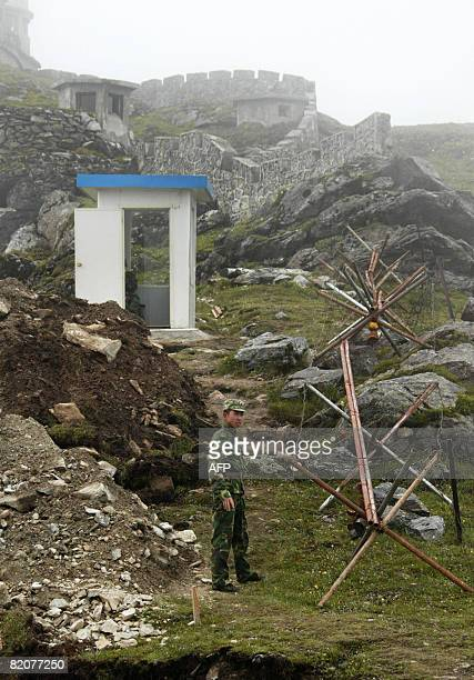 GUPTA 'INDIACHINADIPLOMACYTRADE' In this photograph taken on July 10 2008 a Chinese soldier stands guard near the barbed wire along the ancient Nathu...