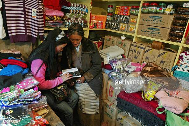 GUPTA 'INDIACHINADIPLOMACYTRADE' In this photograph taken on July 10 2008 a Chinese trader engages with an Indian trader who sells Chinese goods at...