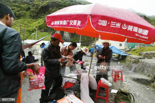 GUPTA 'INDIACHINADIPLOMACYTRADE' In this photograph taken on July 10 2008 Chinese traders engage with Indian customers at Sherathang business mart...