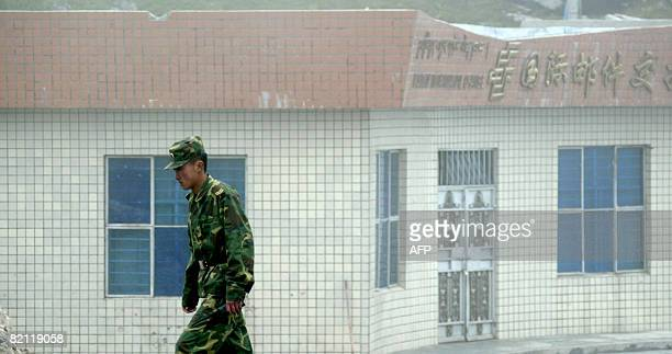 In this photograph taken on July 10 a Chinese soldier stands guard on the Chinese side of the ancient Nathu La border crossing between India and...