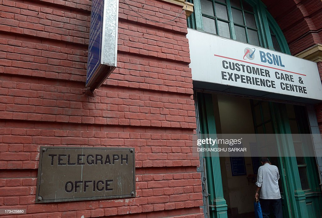 In this photograph taken on July 12, 2013, an Indian pedestrian walks into the Central Telegraph Office in Kolkata. Thousands of Indians crammed into telegram offices to send souvenir messages to friends and family in a last-minute rush before the service shuts down. July 14, 2013, is the last day that messages will be accepted by the 162-year-old service, the last major commercial telegram operation. In the days before mobile phones and the Internet, the telegram network was the main form of long-distance communication, with 20 million messages dispatched from India during the subcontinent's bloody partition in 1947. AFP PHOTO/ Dibyangshu SARKAR