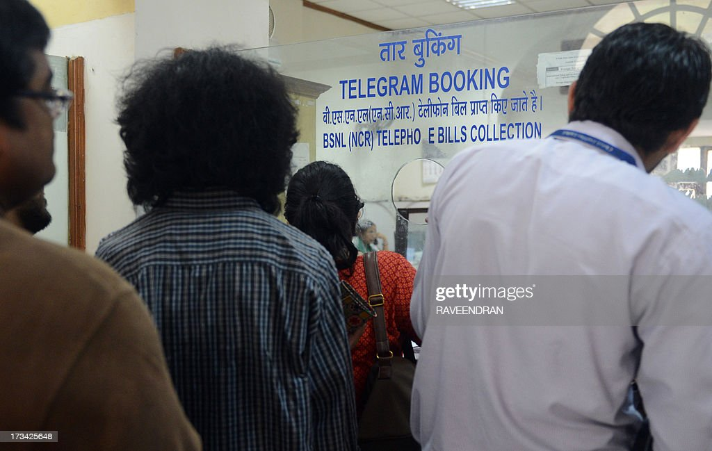 In this photograph taken on July 13, 2013, Indian customers line up in front of a telegraph booking counter to send a telegram in New Delhi. Thousands of Indians crammed into telegram offices to send souvenir messages to friends and family in a last-minute rush before the service shuts down. July 14, 2013, is the last day that messages will be accepted by the 162-year-old service, the last major commercial telegram operation. In the days before mobile phones and the Internet, the telegram network was the main form of long-distance communication, with 20 million messages dispatched from India during the subcontinent's bloody partition in 1947.
