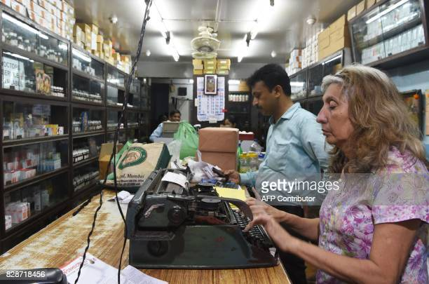 In this photograph taken on July 13 Mahrukh Sam Calagopi types out labels for medicine bottles at her Parsi Homoeopathic Pharmacy in Mumbai The...