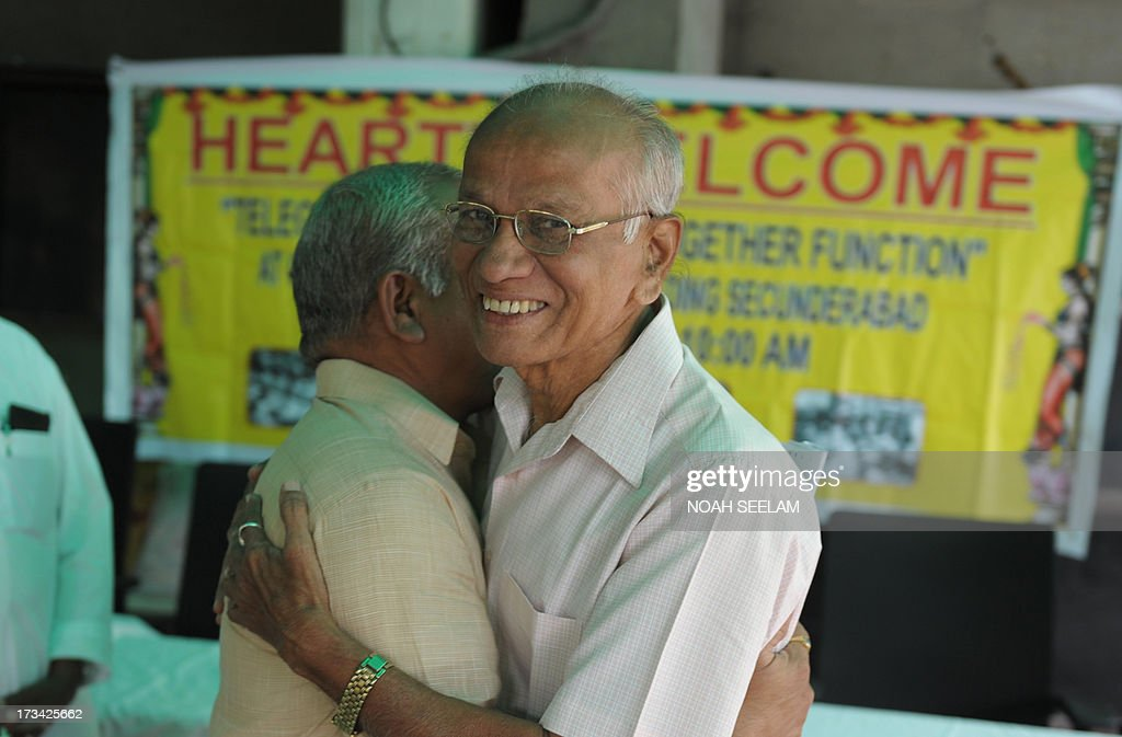 In this photograph taken on July 13, 2013, retired Indian telegraph employees greet each other at a function at the Central telegraph office in Hyderabad. Thousands of Indians crammed into telegram offices to send souvenir messages to friends and family in a last-minute rush before the service shuts down. July 14, 2013, is the last day that messages will be accepted by the 162-year-old service, the last major commercial telegram operation. In the days before mobile phones and the Internet, the telegram network was the main form of long-distance communication, with 20 million messages dispatched from India during the subcontinent's bloody partition in 1947. AFP PHOTO / Noah SEELAM