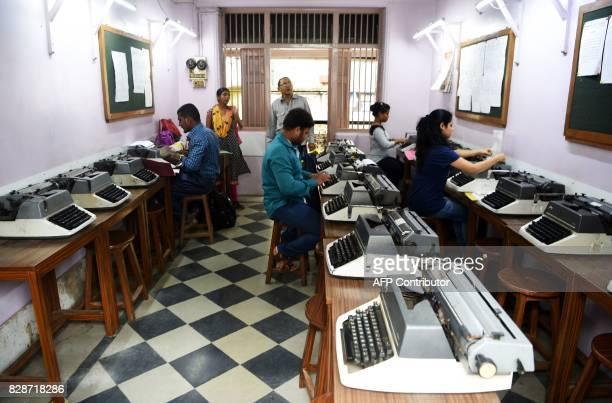 In this photograph taken on July 13 students practise at Abhyankar's Shorthand Typewriting Institute in Mumbai The unmistakable chatter of...