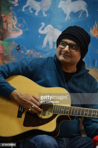 In this photograph taken on July 18 2017 Abhishek Prasad plays guitar during a press conference held at the Mahaveer Jain Hospital in Bangalore An...