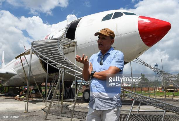 In this photograph taken on July 18 2017 Nepali pilot Bed Upreti talks during an interview with AFP in front of an airplane that has been converted...