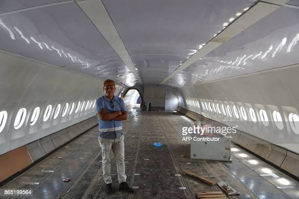 In this photograph taken on July 18 2017 Nepali pilot Bed Upreti poses for a photograph during an interview with AFP in an airplane that has been...