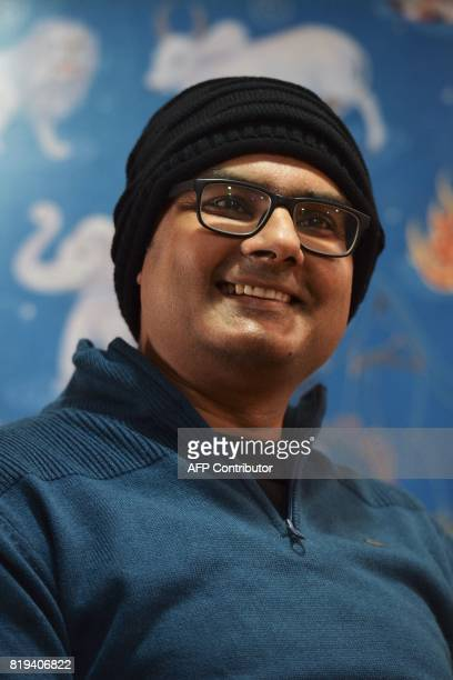 In this photograph taken on July 18 Abhishek Prasad smiles while addressing a press conference held at the Mahaveer Jain Hospital in Bangalore An...